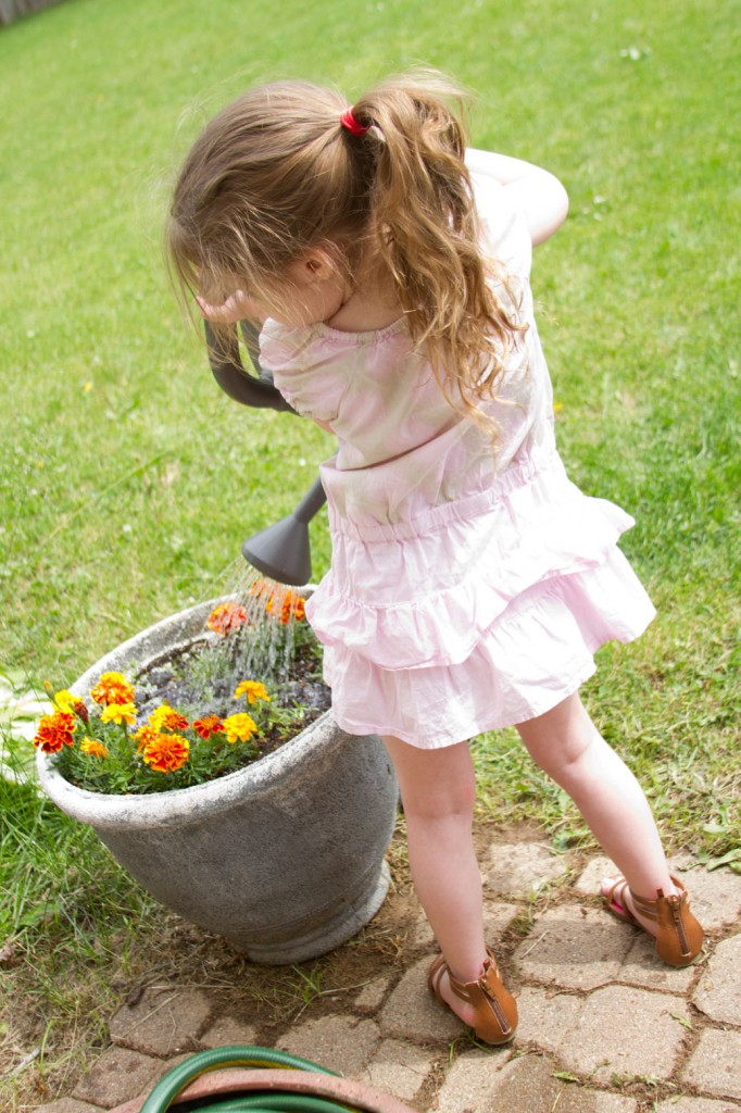 Naylyn watering flowers