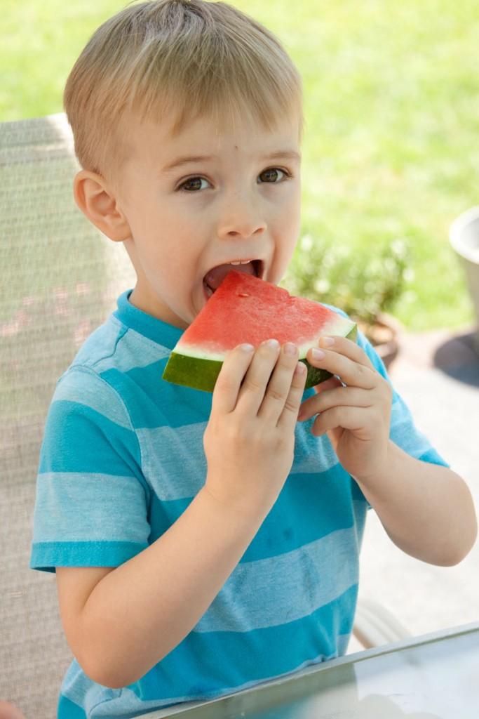 Sawyer eating watermelon